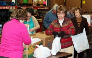 WKMP volunteers packing food bags